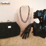 Set pochette clic clac  in cordino nero glitterato con gioielli tessili abbinati